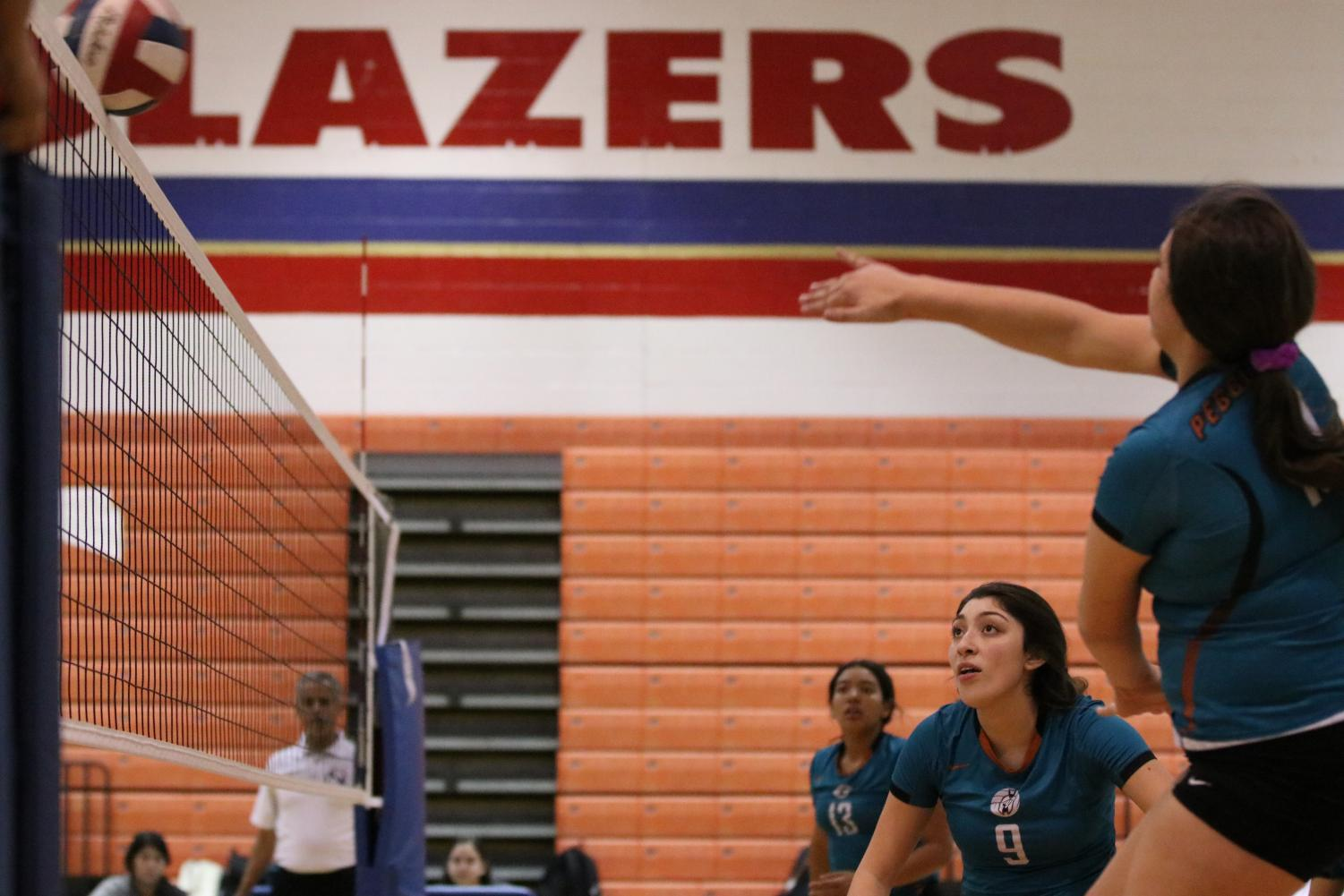 Sophomore Paige Hopper goes for a kill in their play-in game against the Montwood Rams Friday afternoon at Americas High School, Nov. 1.